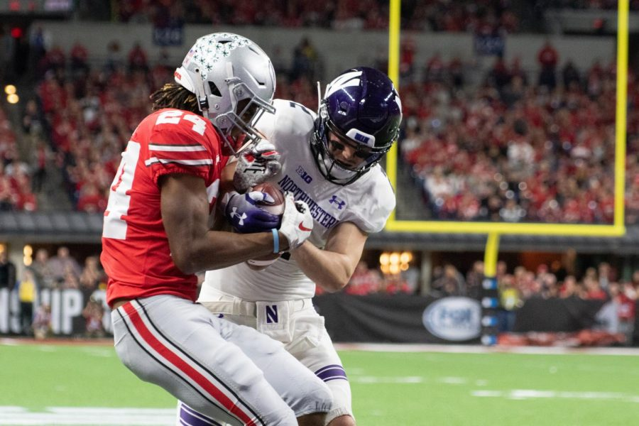 Ohio State cornerback Shawn Wade grabs the ball from Flynn Nagel. NU committed three costly turnovers in Saturday's loss.
