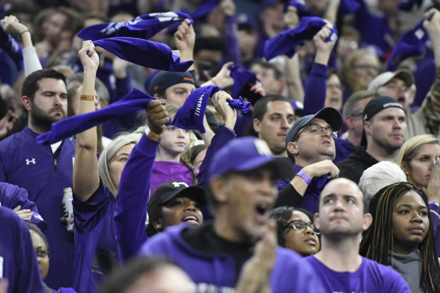 Purple-clad+fans+cheer+on+the+Wildcats+during+Saturday%27s+Big+Ten+Championship+game+in+Indianapolis.