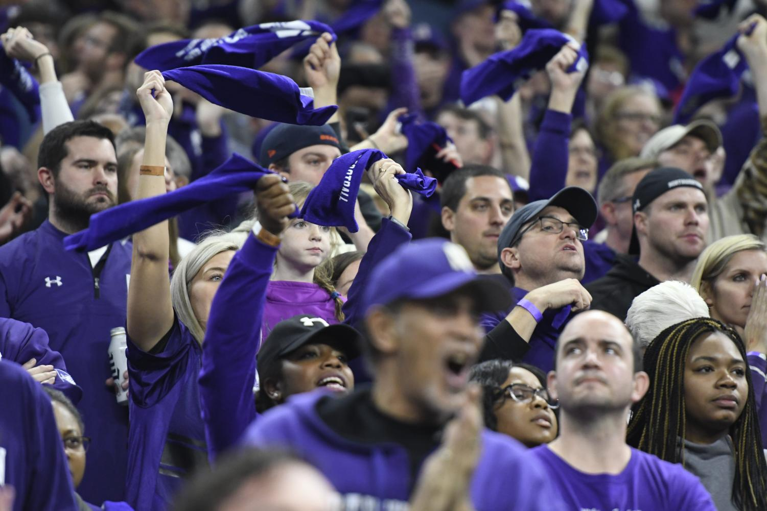Purple-clad fans cheer on the Wildcats during Saturday's Big Ten Championship game in Indianapolis.