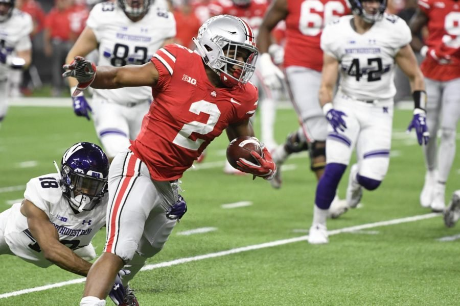 Ohio State running back JK Dobbins breaks away from a tackle during the Buckeyes win over the Wildcats.