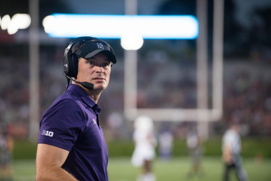Adam Cushing looks towards the end zone. Cushing is leaving Northwestern to take the head coach job at Eastern Illinois.
