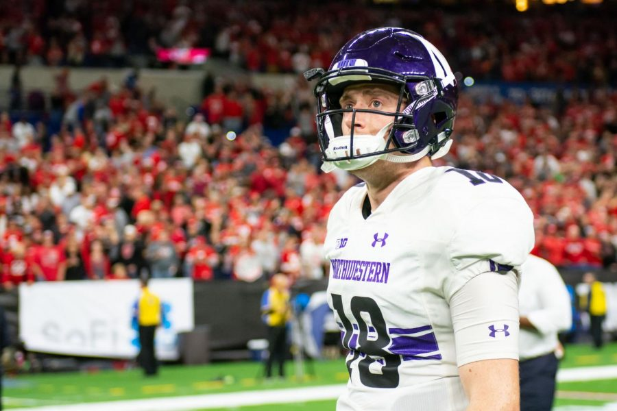 Clayton Thorson surveys the field after Saturday's Big Ten Championship Game. Thorson and the Wildcats fell to Ohio State.