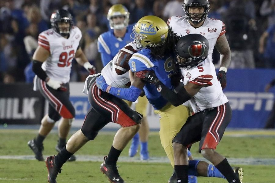 Utah defenders knock the ball out of the hands of a UCLA receiver during a Utes win earlier this season.