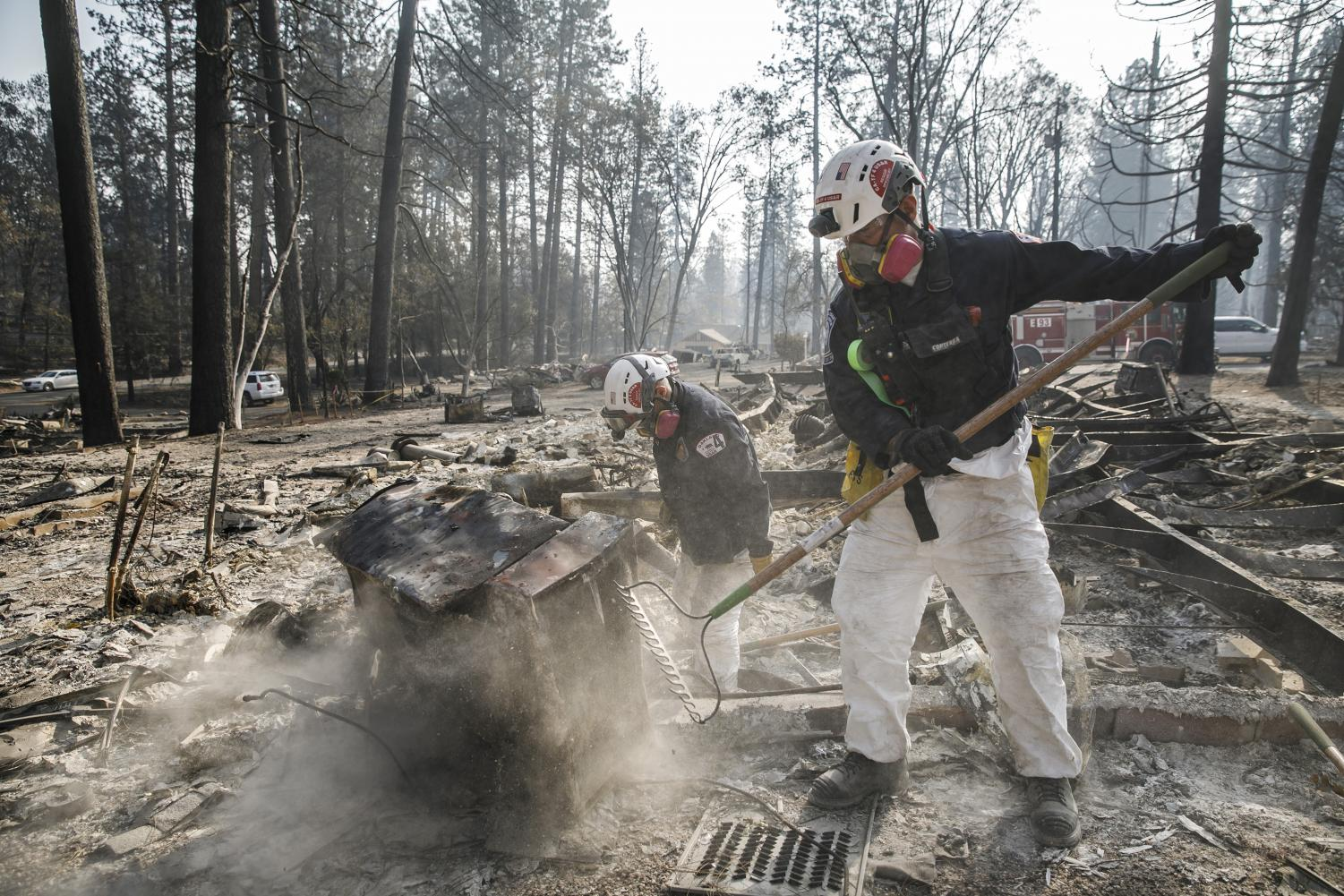 A search and rescue team comb through debris for human remains after the Camp Fire destroyed most of Paradise, Calif., on Nov. 20, 2018.