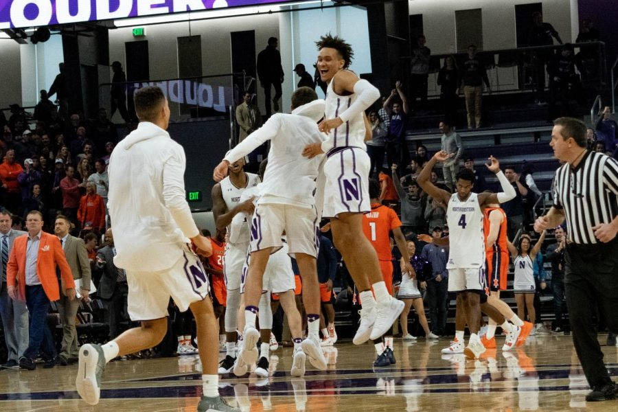 A.J. Turner celebrates with his teammates. The junior forward hit a three-pointer with 11 seconds remaining to elevate Northwestern over Illinois.