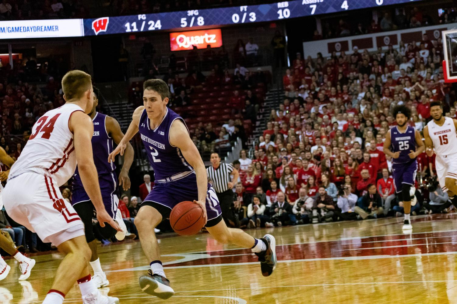 Ryan Greer dribbles the ball. The freshman guard scored six points in the first half on Saturday.