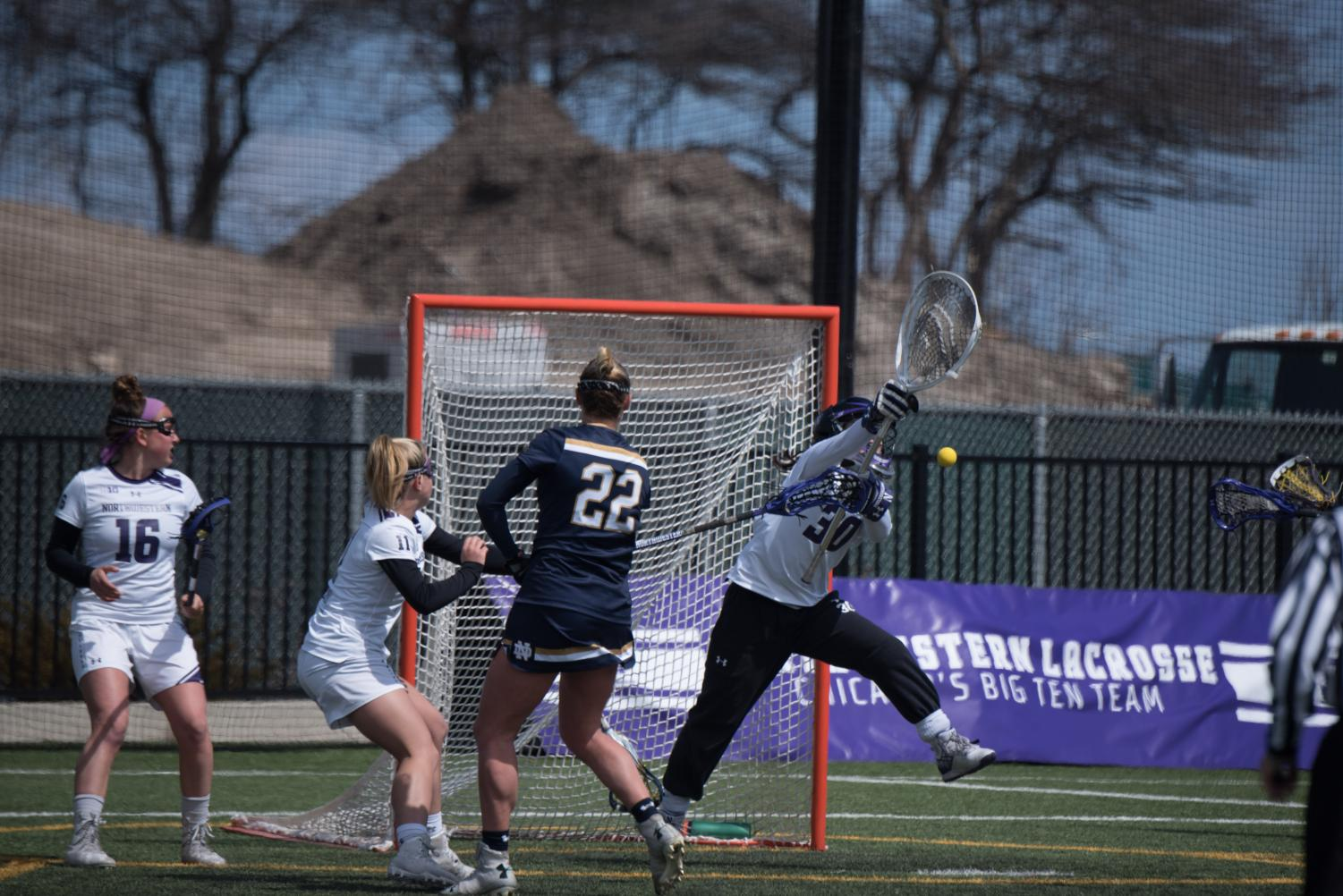 Julie Krupnick deflects a shot. The sophomore will be competing for the starting spot in the net.