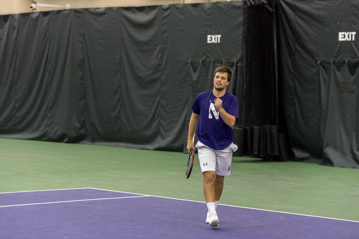 Dominik Stary pumps his first. The junior helped NU secure its first doubles point of the season.