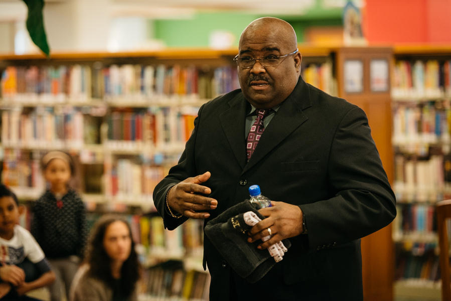 """Reverend Eddie P. Reeves recites Martin Luther King Jr.s """"I Have a Dream"""" speech. Evanston residents gathered at the Evanston Public Library for a Martin Luther King Jr. Day celebration"""