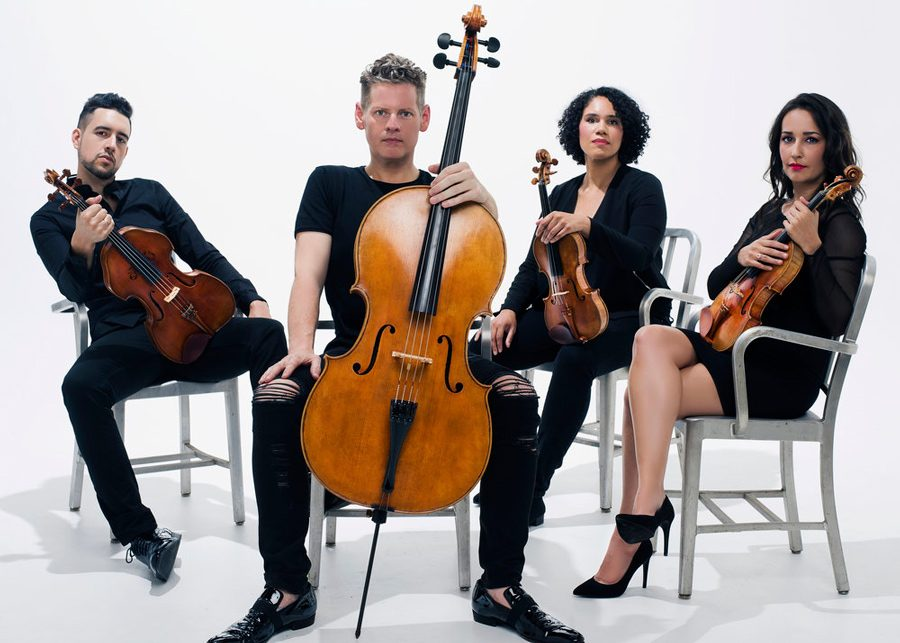 Paul+Laraia%2C+Karlos+Rodriguez%2C+Jessie+Montgomery+and+Karla+Donehew-Perez+pose+with+their+instruments.+Catalyst+Quartet+will+perform+in+Pick-Staiger+Concert+Hall+at+7%3A30+p.m.+Saturday.