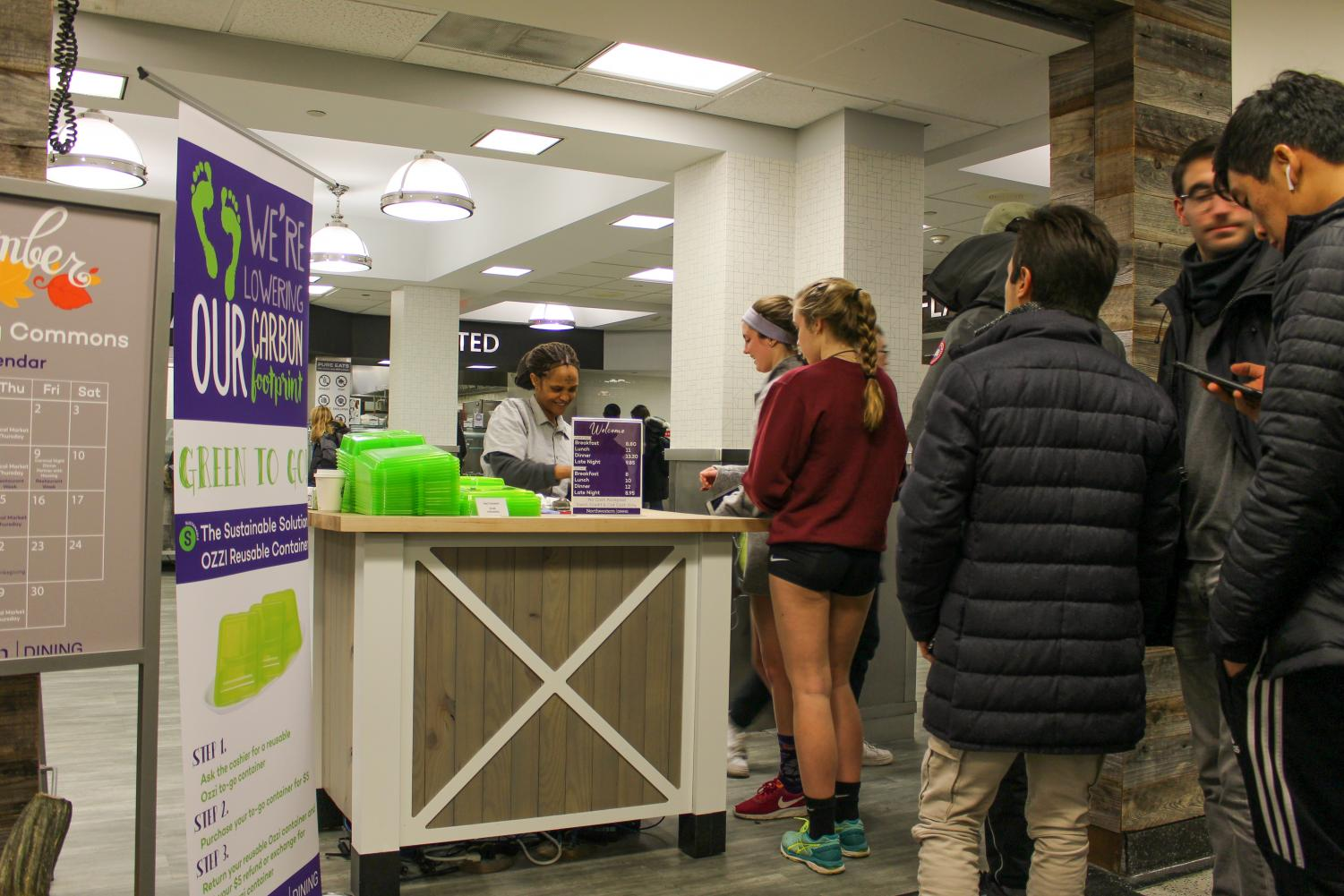 A Compass employee swipes NU students in to Sargent Hall. Northwestern's chapter of Students Organizing for Labor Rights raised more than $2,500 overnight to pay for ridesharing services for Compass employees in the cold temperatures.