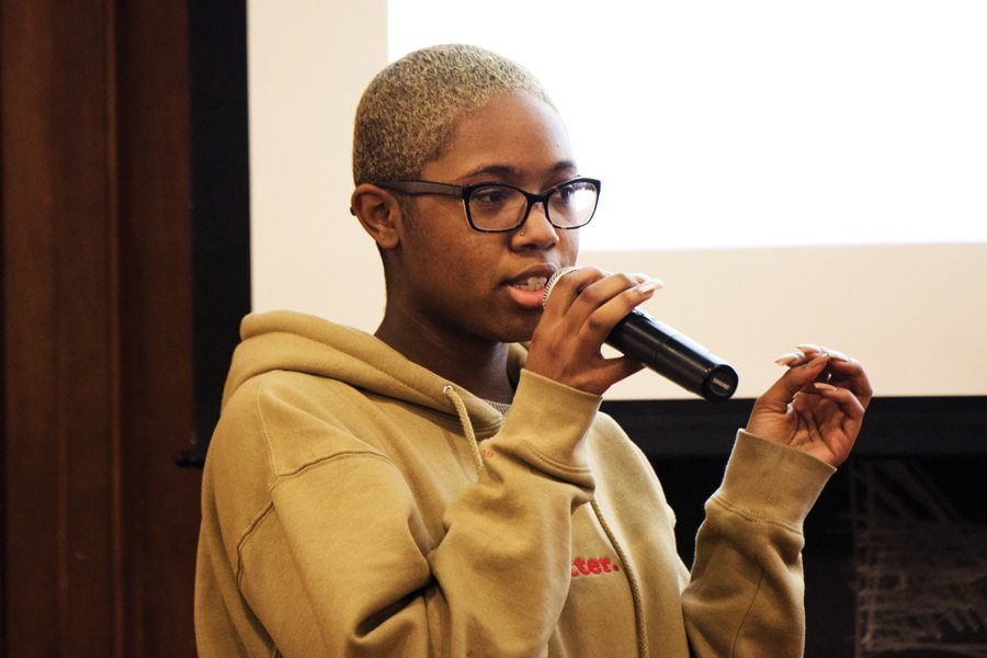 Medill first-year Imani Harris speaks at a town hall on Wednesday held to discuss the presence of controversial visiting scholar Satoshi Kanazawa at NU. The students at the town hall presented demands for the University and strategized for future action.