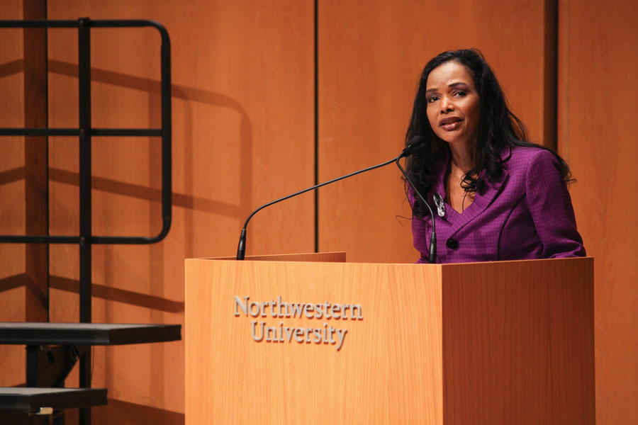 Maggie Anderson speaks at the University-wide MLK commemoration in Pick-Staiger Concert Hall Monday. Anderson discussed her research and advocated for economic equality in the black community