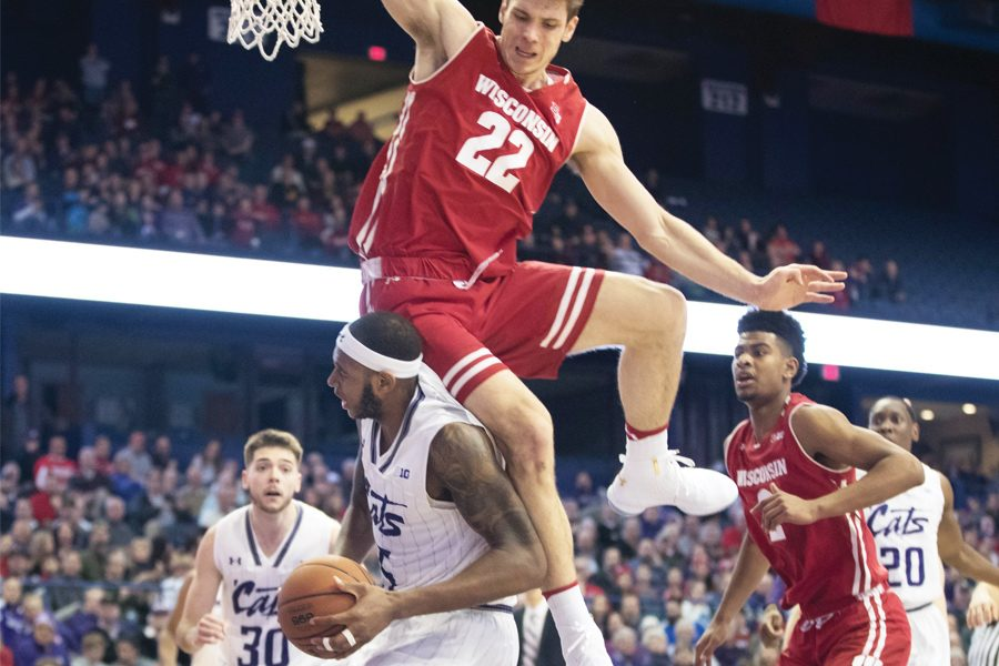 Dererk+Pardon+gets+Ethan+Happ+to+leap+in+the+air.+Pardon+and+Happ+are+two+of+the+best+bigs+in+the+Big+Ten.