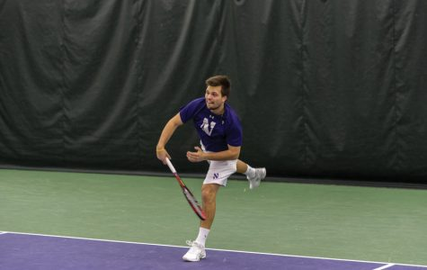 Nick Brookes connects with a backhand. The sophomore lost his singles match last week in three sets.