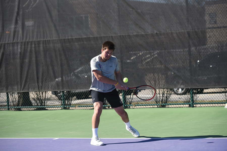 Dominik Stary strikes a backhand. The junior won his singles match 6-3 6-3.
