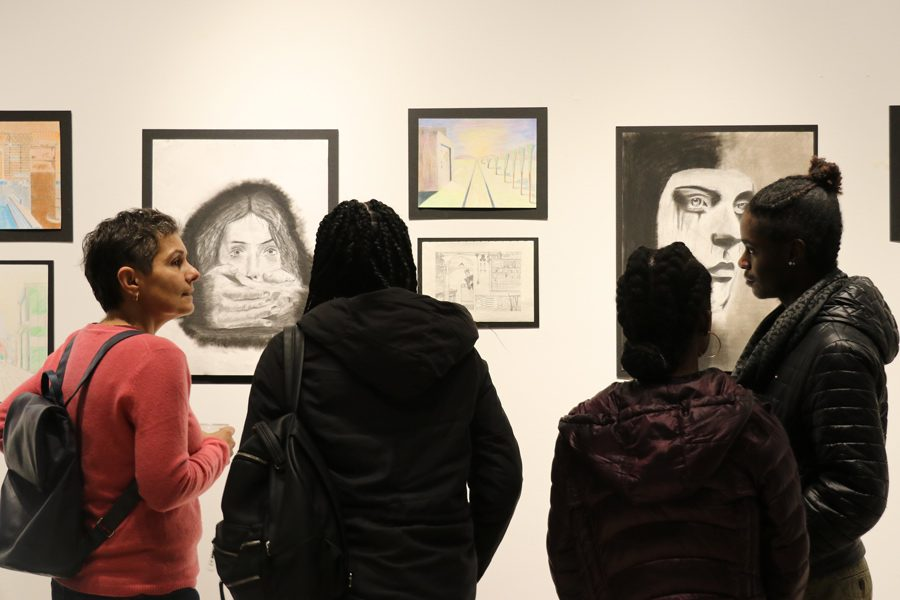 Parents+and+students+attend+the+biannual+art+show.+The+One+River+School+of+Art+%2B+Design+has+been+open+for+seven+months+and+has+over+100+students.+
