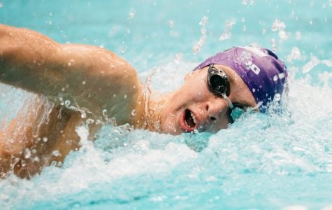 A Northwestern athlete swims freestyle. The Wildcats are heading to Iowa City for a Big Ten tri-dual meet.