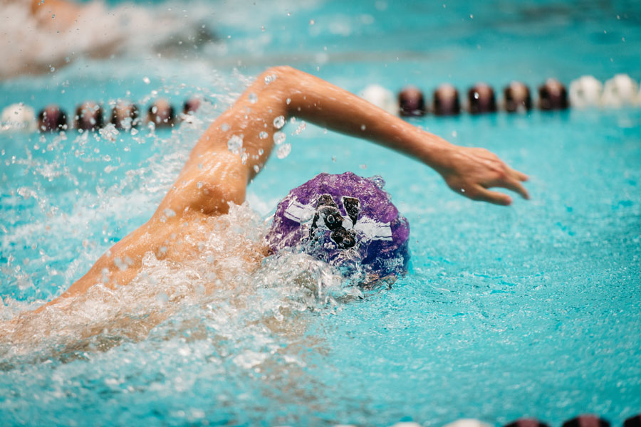 A Northwestern swimmer swims the freestyle. The Wildcats split two weekend meets this week