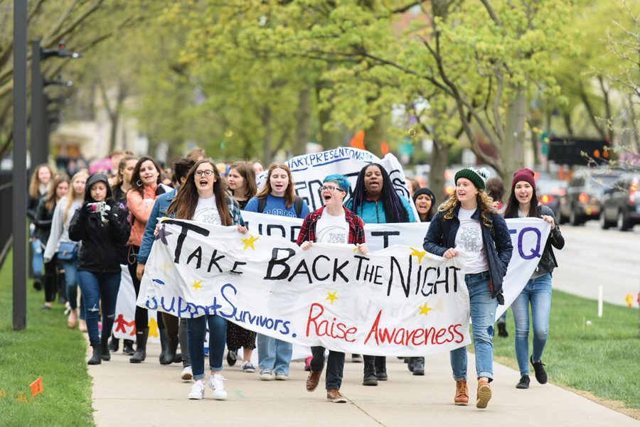 Students march down Sheridan Road in a 2017 Take Back the Night march. Administrators rolled out a new sexual misconduct training program for students, which will be available at the end of January.