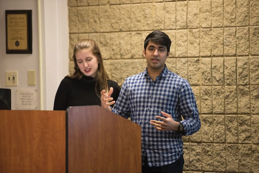 Emily+Ash+and+Sid+Ahuja+speak+at+ASG+Senate.+Ahuja+helped+spearhead+the+expansion+of+a+mandated+student+group+CARE+training+to+club+sports+teams.