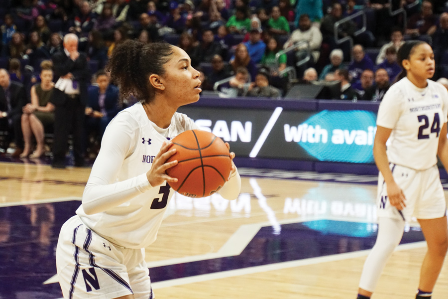 Sydney Wood holds the ball. The freshman guard had a career-high four rebounds in NU's last contest.