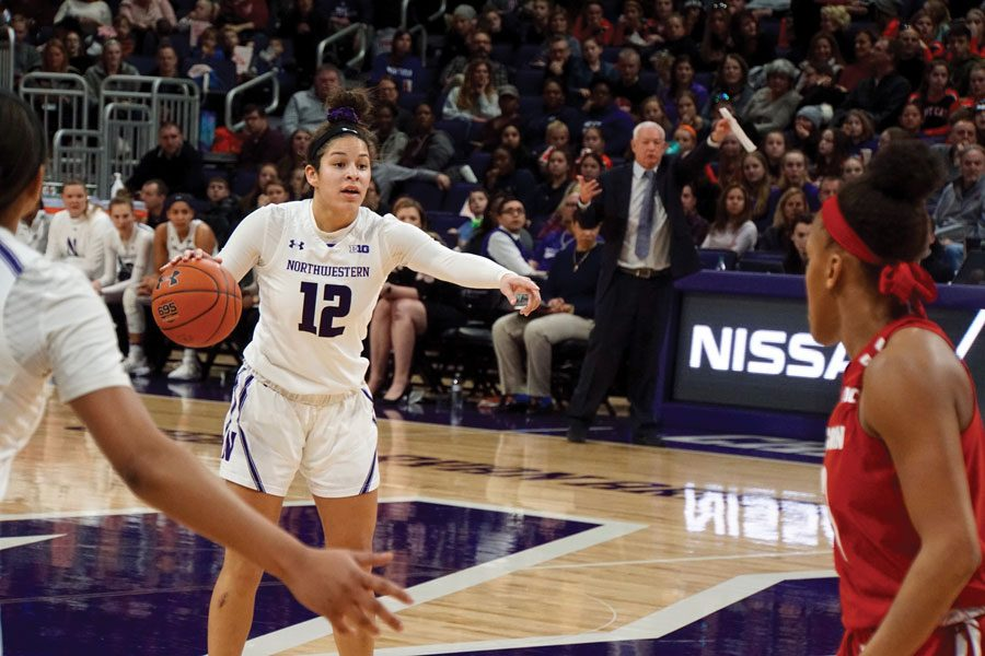 Veronica Burton dribbles the ball. Her presence has made a major difference in Northwestern's improved season