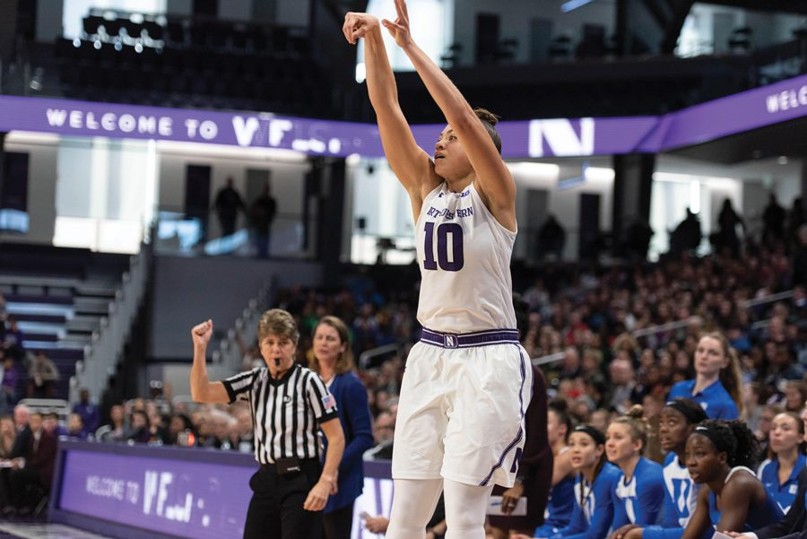 Lindsey Pulliam fires a long two. She led NU with 27 points in an upset over No. 25 Indiana.