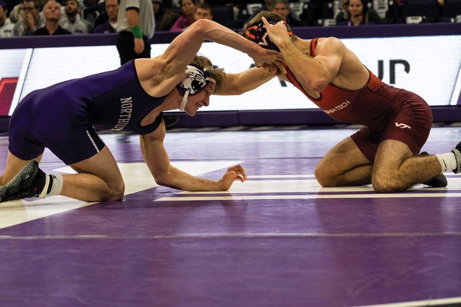 Colin Valdiviez spars with an opponent. Northwestern split its two matches over the weekend, but he had a major win.