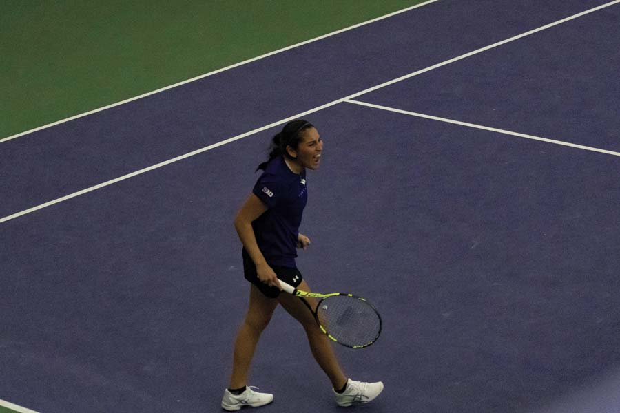 Caroline Pozo celebrates on the court following her dramatic match clinching victory. Against Miami, she won in three sets