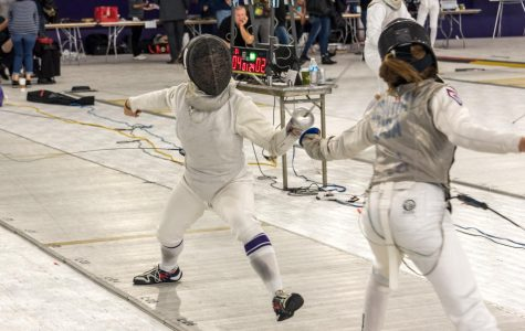 A Northwestern fencer lunges at an opponent. The Wildcats won the Western Invitational last weekend.