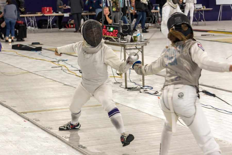 A+Northwestern+fencer+lunges+at+an+opponent.+The+Wildcats+won+the+Western+Invitational+last+weekend.