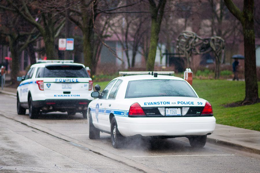 Two parked Evanston police cars. An Evanston man was arrested and charged last week on an outstanding arrest warrant stemming from an October 2018 incident where he fled the scene of the crime and intentionally struck an occupied police car.