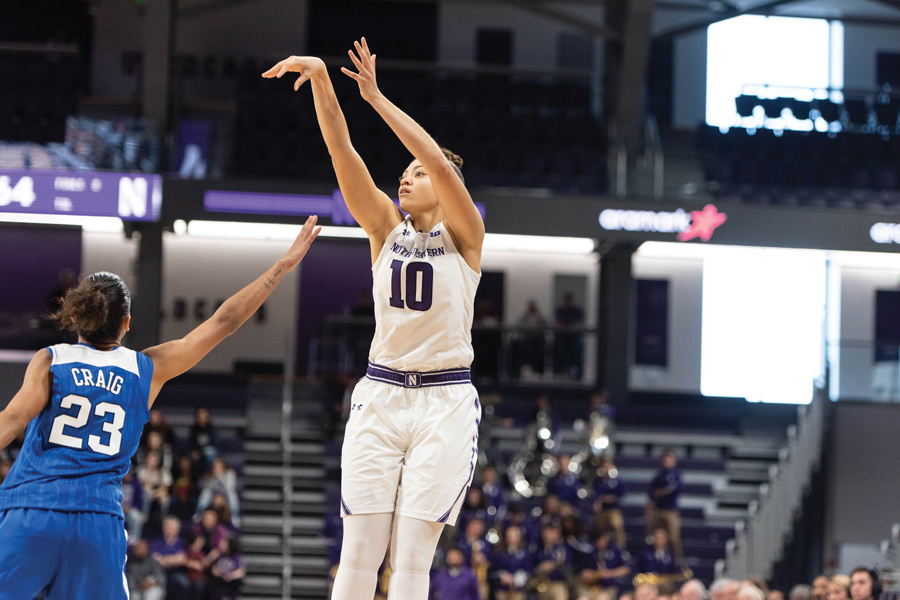 Lindsey Pulliam attempts a jump-shot. The Wildcats missed two potential game-winning shots in Tuesday's overtime loss, including a jumper by Pulliam.