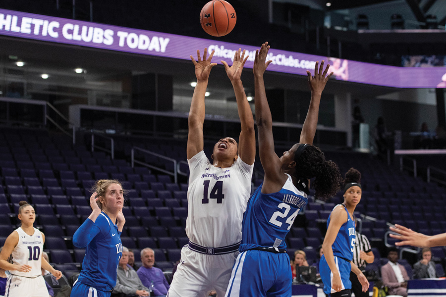 Pallas Kunaiyi-Akpanah goes to grab a rebound. The senior forward is leading the team with 10.6 rebounds per game.