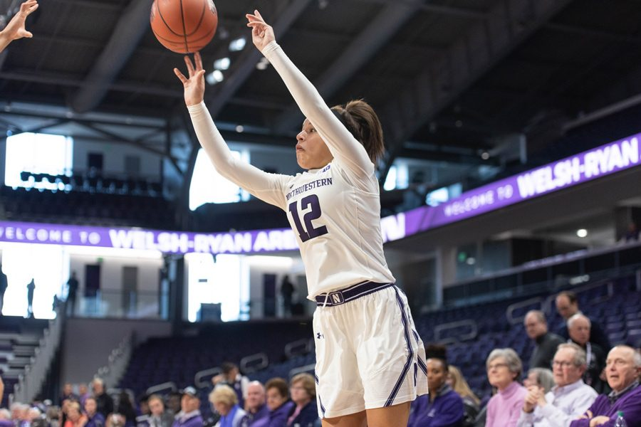 Veronica Burton pulls up for a jumper. The freshman guard made NU's only three of the night.