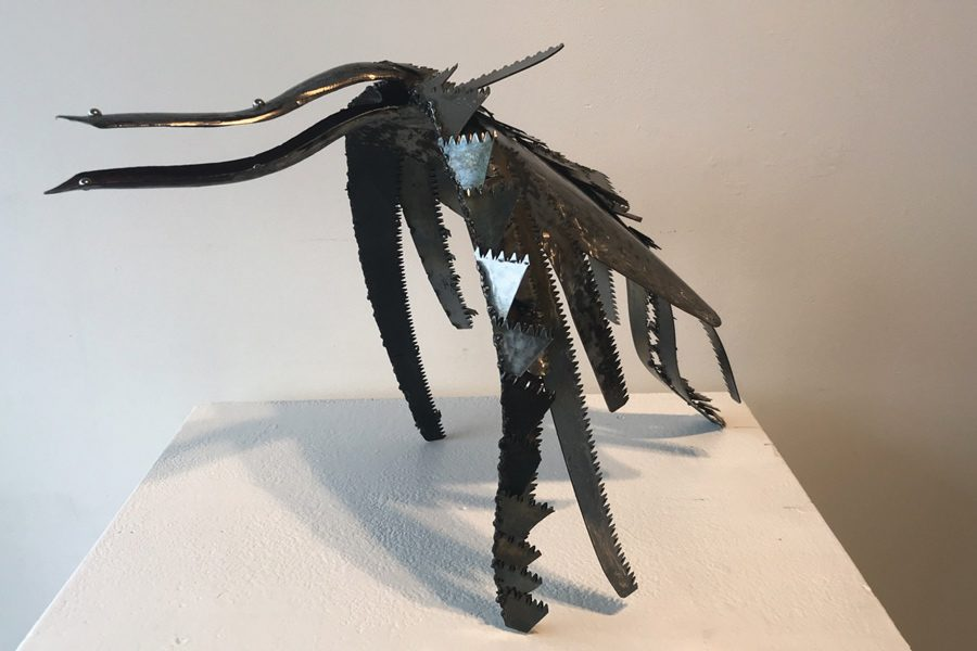 """""""The Bird in Fright,"""" a work by Karl Johnson featured at the Evanston Art Center. Johnson said the materials and the subject emphasized the contradiction of industrialism and nature."""