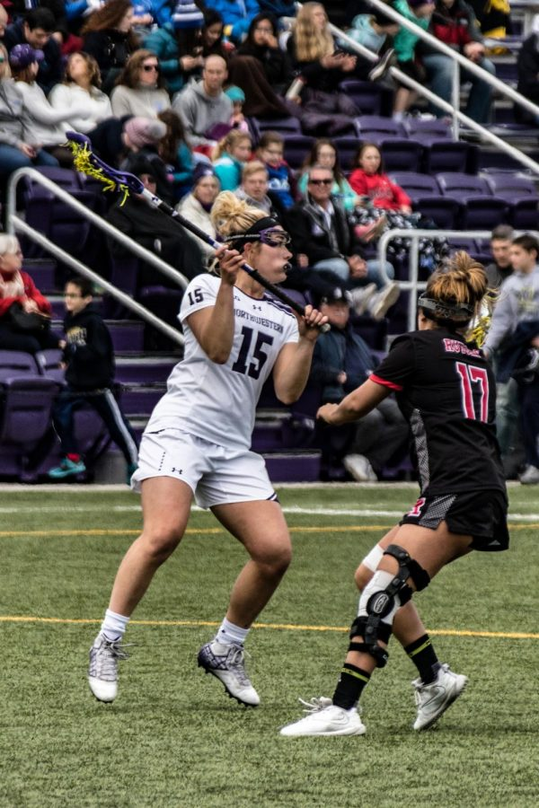 Jill Girardi carries the ball. The Cats have a difficult pair of nonconference games this week.