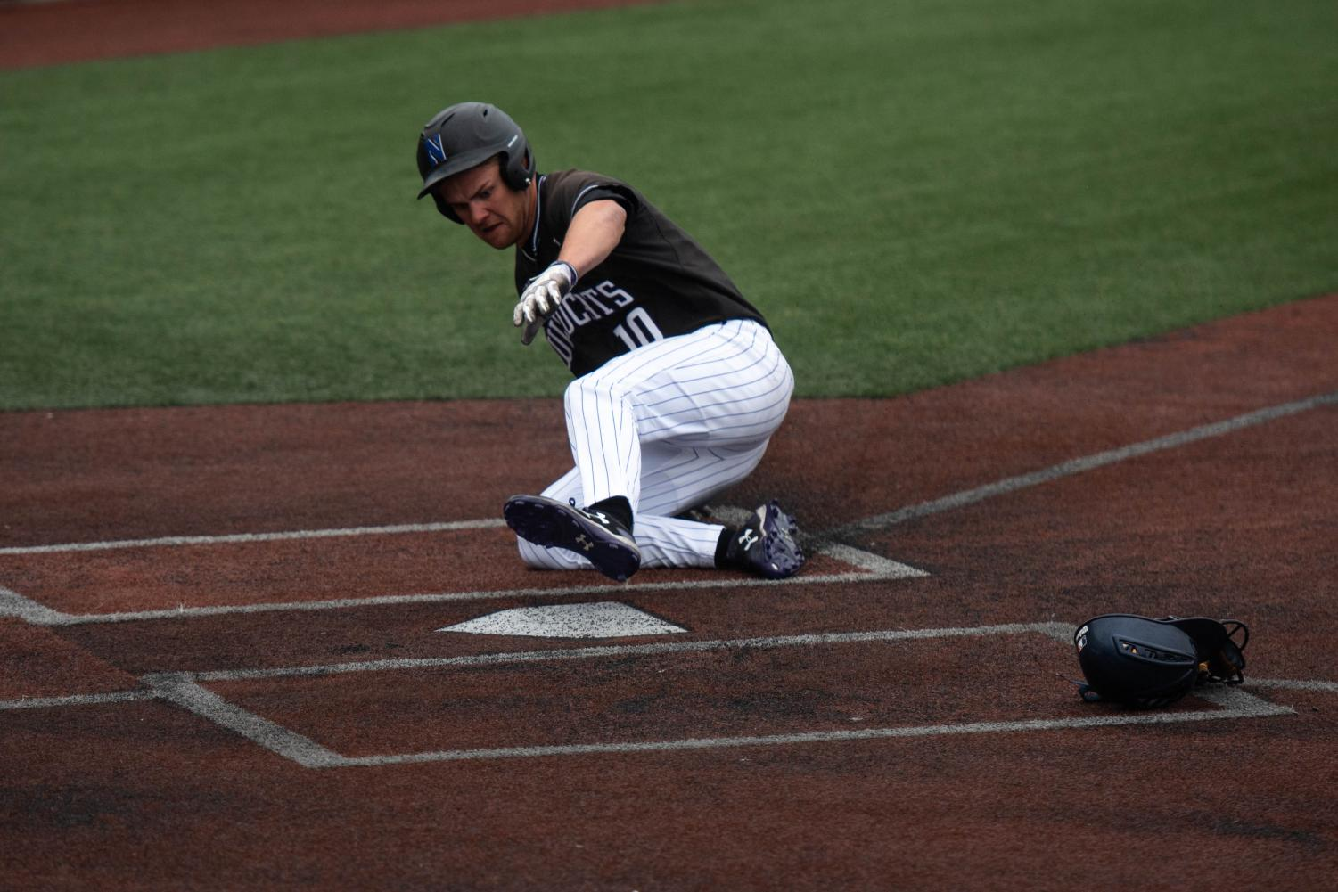 Ben Dickey slides safely into home. Dickey and the Wildcats travel to Durham this weekend.