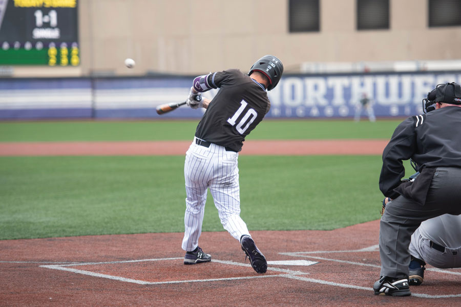 Ben Dickey hits a line drive. The senior scored a run Sunday in a 2-2 weekend for NU.