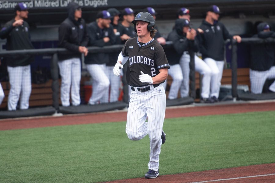 Jack Dunn rounds third and heads for home. The senior and his brother David have led Northwestern's offense this year.