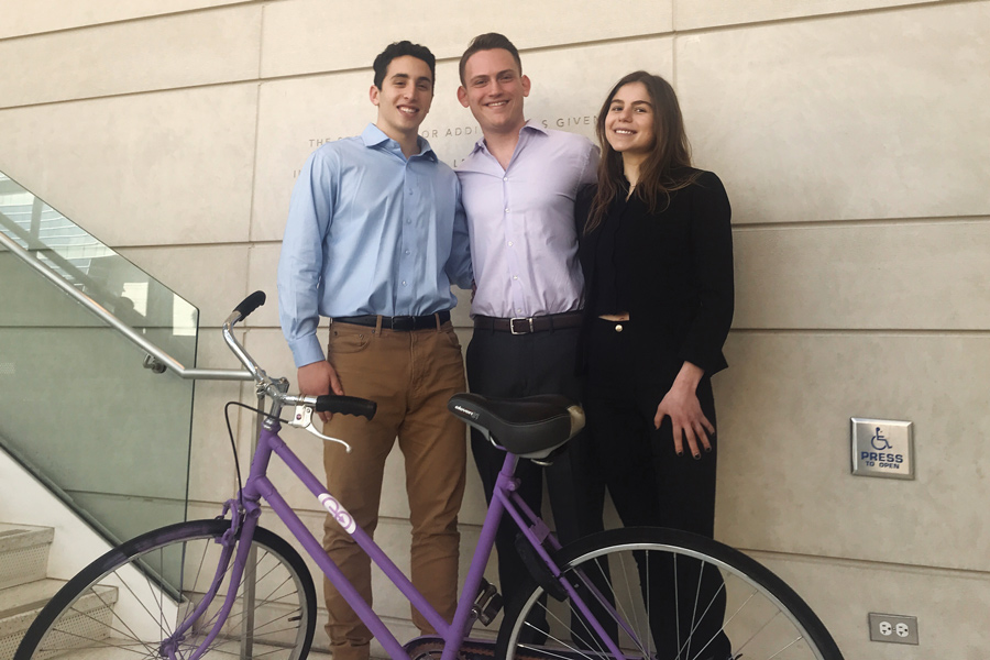 Eo team members Drake Weissman, Jake Gutstein and Grace Jaeger (left to right) pose with a prototype bike. Eo plans to launch a pilot program for their bike-share in the spring.