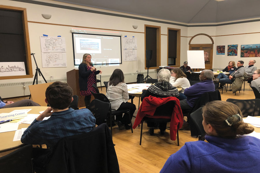 Residents gather in tables at a community meeting hosted by Harley Clarke Community. Evanston residents discussed the future of Harley Clarke Mansion on Thursday.