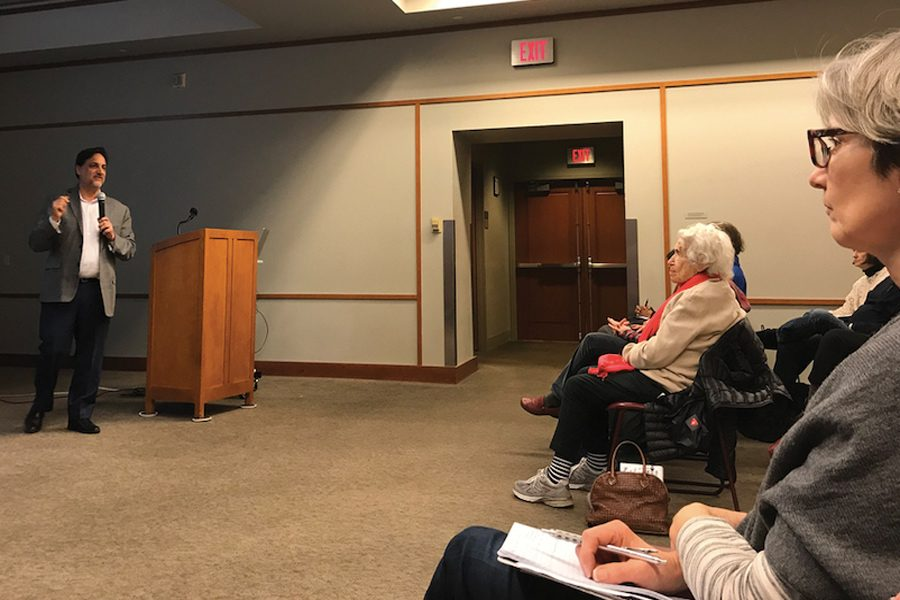 David Waskow gives a talk on climate change at Evanston Public Library. Waskow said concrete facts, along with youth movements, are key to the fight against climate change.