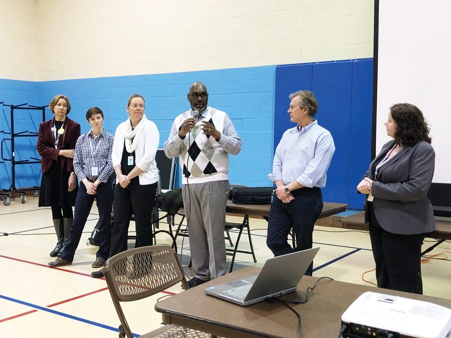 Ald. Donald Wilson (4th), Evanston Public Library director Karen Danczak Lyons, Parks, Recreation and Community Services Director Lawrence Hemingway and the city's senior management analyst Kate Lewis-Lakin address concerns from Evanston residents.