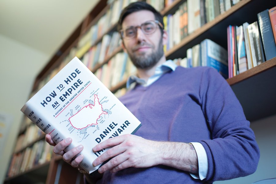 "History Prof. Daniel Immerwahr with his new book ""How to Hide an Empire."" Immerwahr said Americans need to consider U.S. territories when thinking about the history of the United States."