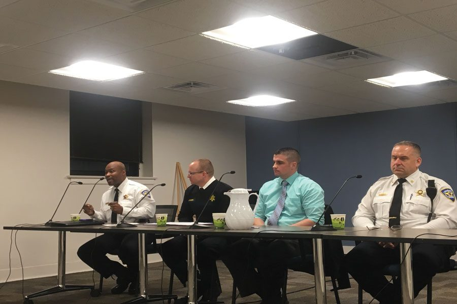 Evanston+Police+Department+officials+James+Pickett%2C+Jeff+Faison%2C+Tom+Giese+and+Ryan+Glew+sit+on+a+panel+at+a+town+hall+meeting+Thursday.+The+panel+discussed+the+need+for+increased+communication+and+transparency+between+police+and+community+members.+