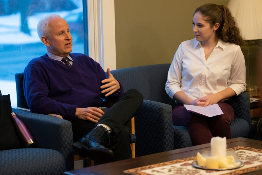 University President Morton Schapiro discusses his faith with Taylor Brown at Canterbury House. Schapiro said he would not be able to be University president if not for his practice of attending Shabbat services every week.