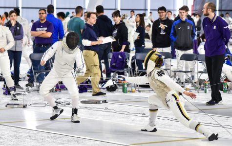 A Northwestern fencer dodges an opponent. The Wildcats are headed to Duke this weekend.