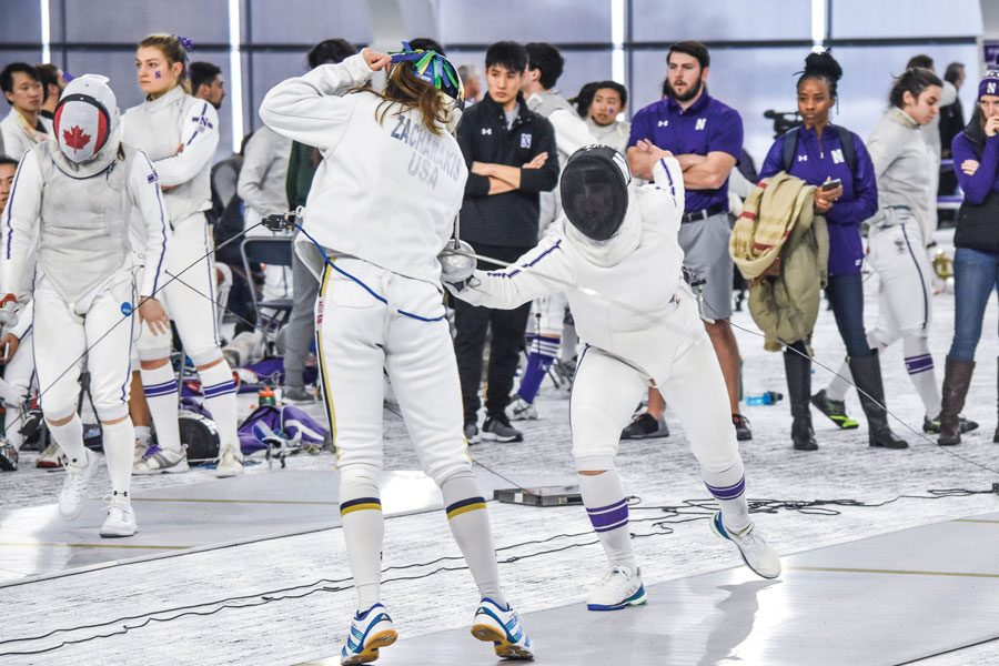 A Northwestern fencer duels an opponent. The Wildcats had a mixed weekend, following up losses to Duke, North Carolina and Temple with wins over Denison and North Carolina.